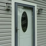 New front entry door with PVC trim installation - Midcoast Maine - New Leaf Construction